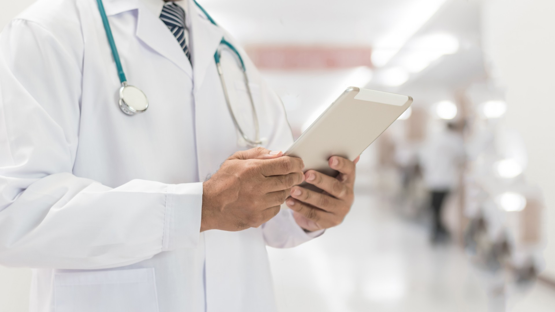 Image of a physician viewing medical records.