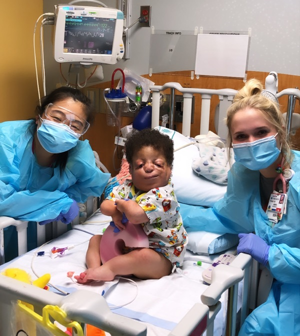 Austin shows off some of her hard-working teammates from the 8th floor. Here we have nurse practitioner, Katie, and nurse Anna with their patient Gabe.