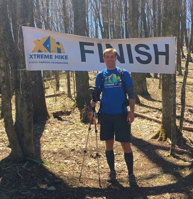 Chris Raymond, 37, is seen here at the Xtreme Hike, which is a one-day 30-mile hike of a section of the Appalachian Trail near the North Carolina-Tennessee border. This year, Chris was the first finisher – an amazing achievement considering he has CF.