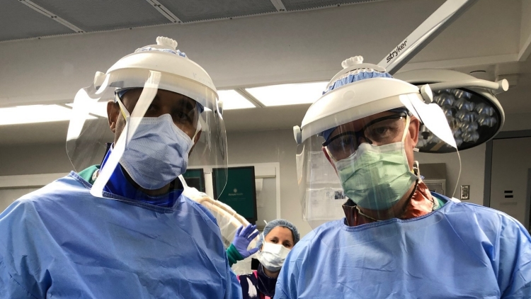 Employees at Hendrick Motorsports make face shields to donate to Atrium Health as additional PPE