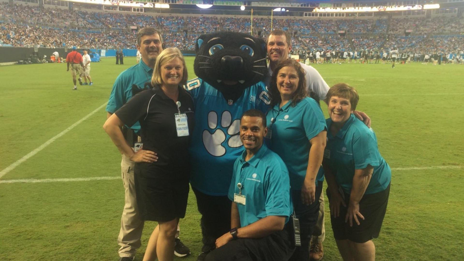 Connie and Atrium Health team at Carolina Panthers football game