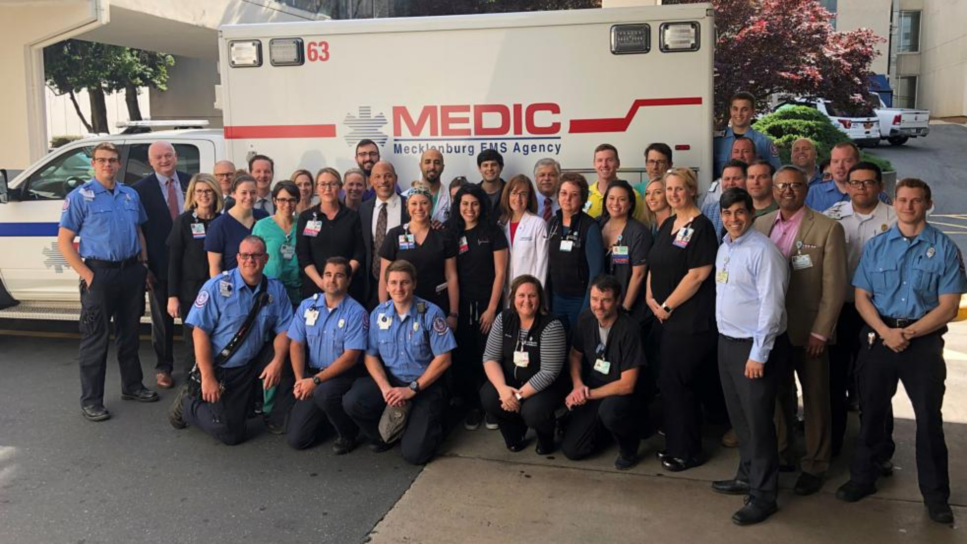 Eugene A. Woods, president and chief executive officer of Atrium Health, with the staff of Atrium Health's Carolinas Medical Center's Emergency Department and MEDIC.