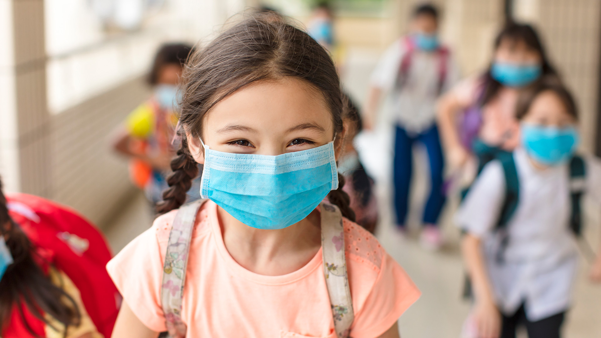 As COVID-19 cases rise in children, a pediatric infectious disease expert offers advice on helping kids return to school safely