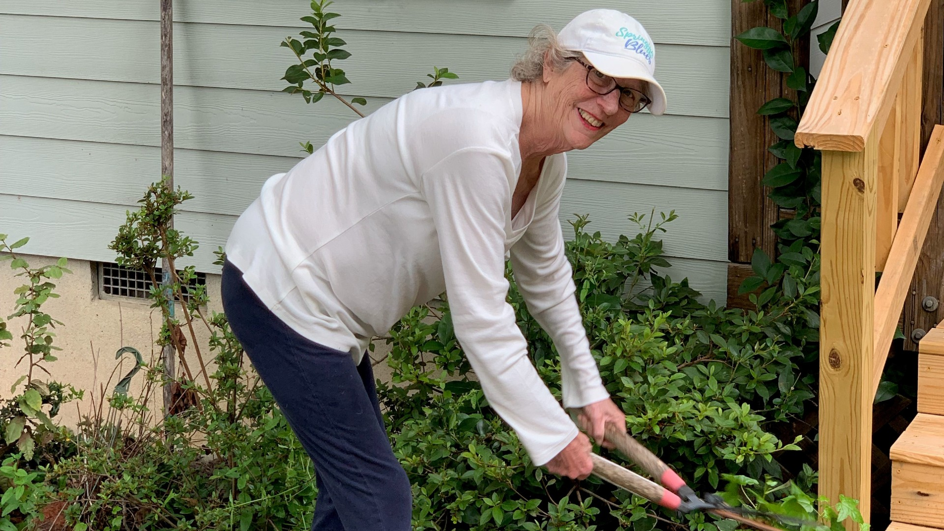 Becky Palmer working in her yard